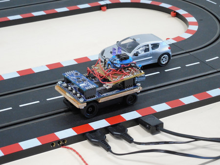 picture of slot car prototype on the tracks, a manually controlled slot car on the second track
